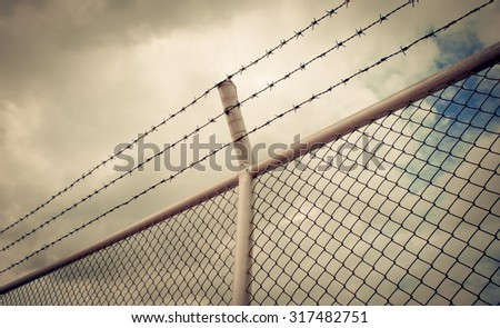 barbed wire fence,protection concept,border,saperation - stock photo