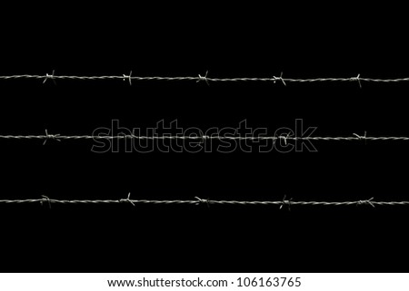 barbed wire isolated on black - stock photo