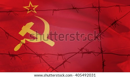 Barbed wire on the background of the flag of the USSR - stock photo