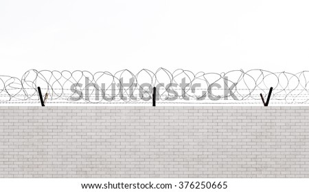 Barbed wire over concrete wall - stock photo
