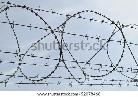Barbed-wire over sky - stock photo