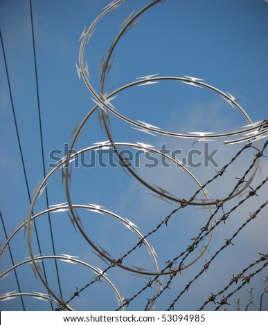 barbed wire razor fence - stock photo