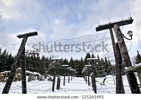 Barbed wire, remains of iron curtain on Czech-German border in winter with snow