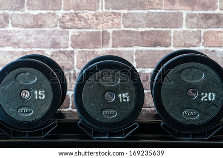barbel weights in gym builing in thailand - stock photo