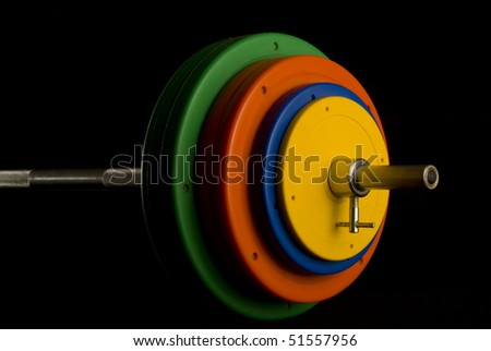 Barbell on a black background. - stock photo