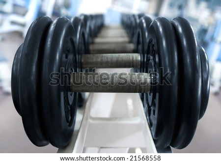 Barbell on blue background