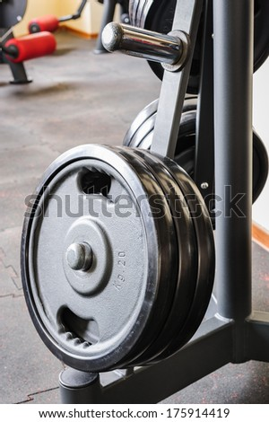 Barbell plates holder rack in the gym