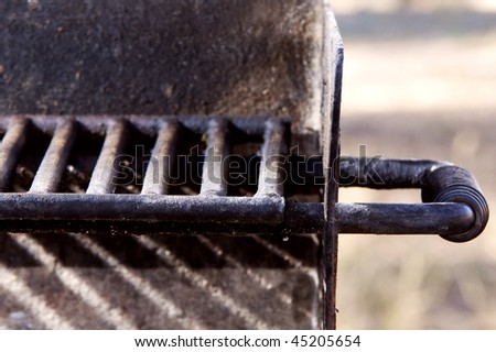 Barbeque grill grate and handle - stock photo