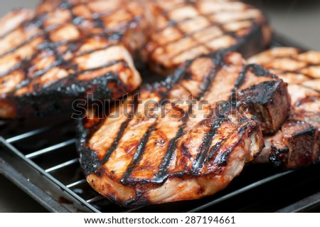 barbequed pork chops fresh grom the grill with delicious sauce - stock photo