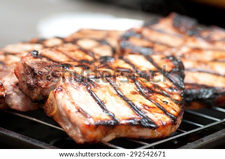 barbequed pork chops fresh grom the grill with delicious sauce