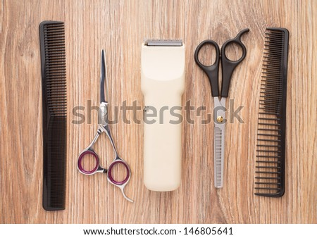 Barber accessories on wooden table - stock photo