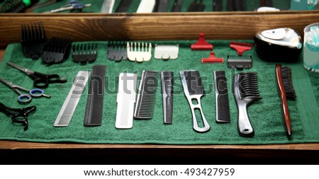 Barber shop equipment on green towel