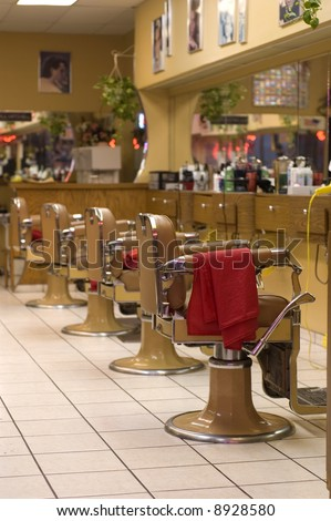 Barber Shop image showing chairs in a row - stock photo