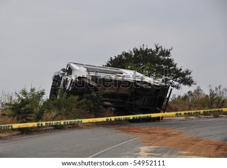 BARBERTON, SOUTH AFRICA - JUNE 10: Scene of bus crash where two British Tourists were killed and as many as 18  others were injured  June 10, 2010 just outside Barberton, South Africa. - stock photo