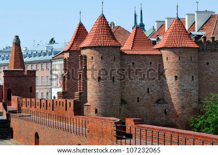 Barbican - Fortified medieval outpost in Warsaw, Poland. Summer time. - stock photo