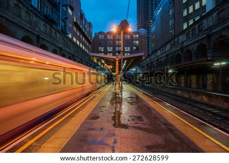 Barbican station, captured with a train leaving. - stock photo