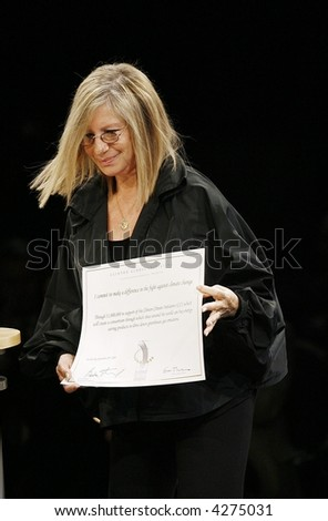 Barbra Streisand walks off stage during the closing of The Clinton Global Iniitative summit on September 22, 2006 in  New York City.   . - stock photo