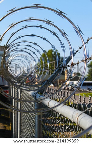 Barbwire and razor fence     Save to a Lightbox ?            Find Similar Images     Share ?  Barbwire and metal fence  - stock photo