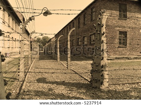 Barbwire fence in Auschwitz I concentration camp in Poland - stock photo
