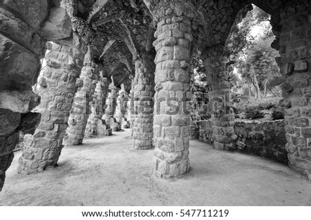 Barcelona: Amazing stone arches at Park Guell, the famous and beautiful park designed by Antoni Gaudi, one of the highlights of the city