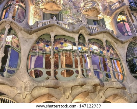 BARCELONA - APR 24: Casa Mila or La Pedrera on April 24, 2008 in Barcelona, Spain. This famous building was designed by Antoni Gaudi and is one of the most visited of the city - stock photo
