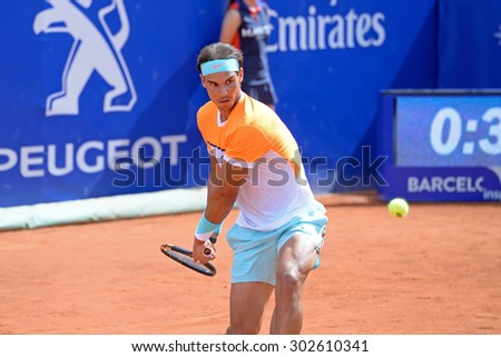 BARCELONA - APR 22: Rafa Nadal (Spanish tennis player) plays at the ATP Barcelona Open Banc Sabadell Conde de Godo tournament on April 22, 2015 in Barcelona, Spain. - stock photo