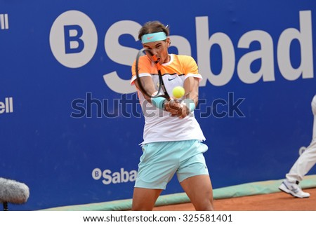 BARCELONA - APR 22: Rafael Nadal (Spanish tennis player) plays at the ATP Barcelona Open Banc Sabadell Conde de Godo tournament on April 22, 2015 in Barcelona, Spain.