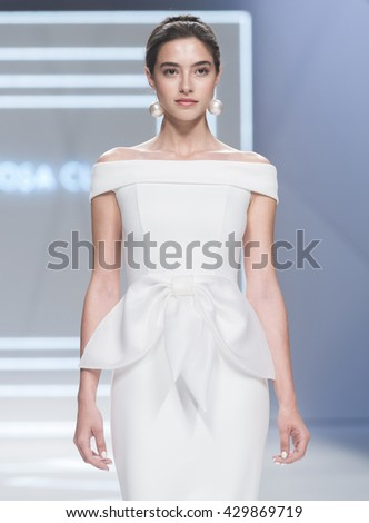 BARCELONA - APRIL 26: a model walks on the Rosa Clara bridal collection 2017 catwalk during the Barcelona Bridal Fashion Week runway on April 26, 2016 in Barcelona, Spain.  - stock photo