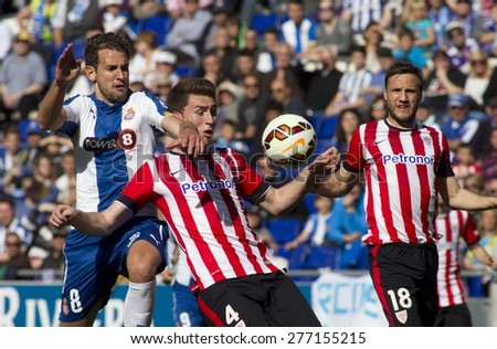 BARCELONA - APRIL, 12: Christian, Stuani of RCD Espanyol(L) and Aymeric Laporte(R) of Athletic de Bilbao during a Spanish League match at the Power8 Stadium on April 12 2015 in Barcelona Spain - stock photo