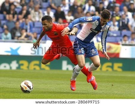 BARCELONA - APRIL, 25: Dani Alves(L) of FC Barcelona fights with Victor Alvarez(R) of Espanyol during a Spanish League match at the Power8 stadium on April 25, 2015 in Barcelona, Spain - stock photo