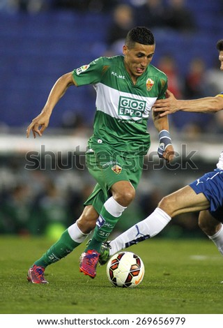 BARCELONA - APRIL, 6: Faycal Fajr of Elche CF during a Spanish League match against RCD Espanyol at the Estadi Cornella on April 6, 2015 in Barcelona, Spain - stock photo