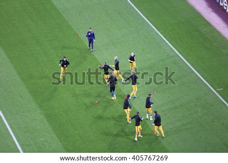 Barcelona April 05 - 2016: Football players are warming up at the Camp Nou stadium on Champions league match between FC Barcelona and Atletico Madrid,  April 05, 2016, in Barcelona, Spain. - stock photo