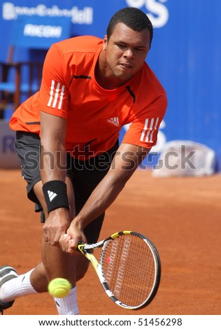 BARCELONA - APRIL 21: French Jo-Wilfried Tsonga in action during the second round match of the Barcelona tennis tournament Conde de Godo on April 21, 2010 in Barcelona. - stock photo