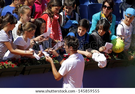 BARCELONA - APRIL, 24: French tennis player Edouard Roger-Vasselin autograph signing after of a match of Barcelona tennis tournament Conde de Godo on April 24, 2013 in Barcelona - stock photo