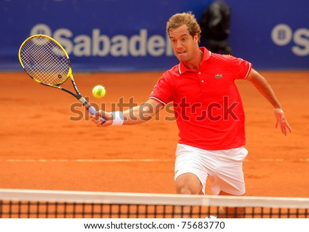BARCELONA - APRIL 19: French tennis player Richard Gasquet in action during the first round match of the Barcelona tennis tournament Conde de Godo on April 19, 2011 in Barcelona - stock photo