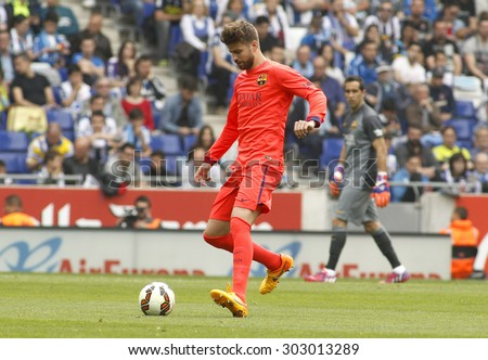 BARCELONA - APRIL, 25: Gerard Pique of FC Barcelona during a Spanish League match against RCD Espanyol at the Power8 stadium on April 25 2015 in Barcelona Spain - stock photo