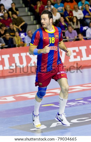 BARCELONA - APRIL 24: Iker Romero in action during the handball Champions League match between FC Barcelona & THW Kiel on April 24, 2011 in Barcelona, Spain. Final score, 27 - 25.