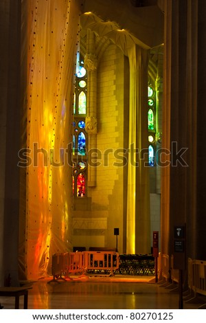 BARCELONA - APRIL 28: Inside La Sagrada Familia - the amazing cathedral designed by Gaudi, in construction since 1882, after Pope Benedict XVI consecration in 2010. April 28, 2011, Barcelona, Spain. - stock photo
