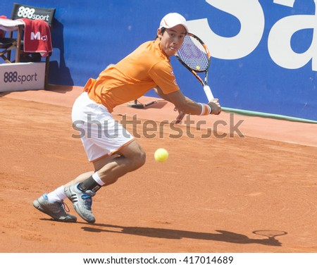 BARCELONA - APRIL 23: Japanese tennis player Key Nishikori  returns a ball during the Barcelona Open Banc Sabadell at Real Club Tenis Barcelona, on April 23, 2016 in Barcelona, Spain.