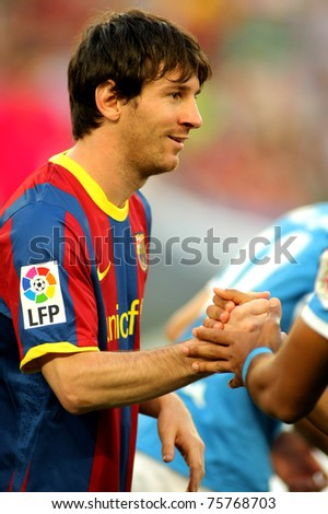 BARCELONA - APRIL 9: Leo Messi of Barcelona shake hands before  the match between FC Barcelona and UD Almeria at the Nou Camp Stadium on April 9, 2011 in Barcelona, Spain - stock photo