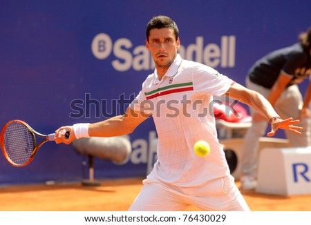 BARCELONA - APRIL 21: Romanian tennis player Victor Hanescu in action during his match against David Ferrer  of Barcelona tennis tournament Conde de Godo on April 21, 2011 in Barcelona, Spain - stock photo