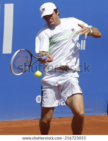 BARCELONA - APRIL, 24: Russian tennis player Teymuraz Gabashvili in action during a match of Barcelona tennis tournament Conde de Godo on April 24, 2014 in Barcelona - stock photo