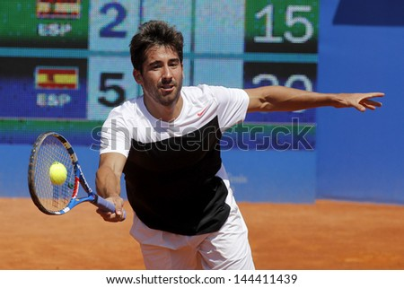 BARCELONA - APRIL, 23: Spanish tennis player Marc Lopez in action during his match against Tommy Robredo of Barcelona tennis tournament Conde de Godo on April 23, 2013 in Barcelona - stock photo