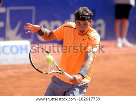 BARCELONA - APRIL, 26: Spanish tennis player Rafael Nadal in action during his match against Robert Farah of Barcelona tennis tournament Conde de Godo on April 26, 2012 in Barcelona - stock photo