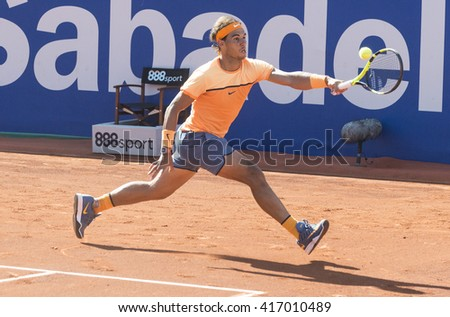 BARCELONA - APRIL 23: Spanish tennis player Rafael Nadal returns a ball during the Barcelona Open Banc Sabadell at Real Club Tenis Barcelona, on April 23, 2016 in Barcelona, Spain.  - stock photo