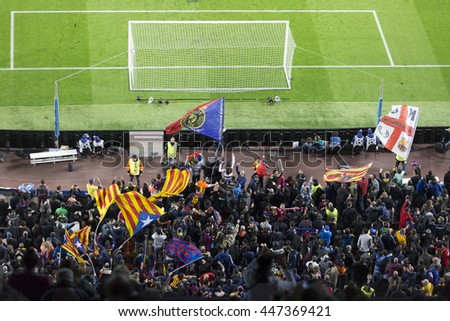 Barcelona April 05 - 2016: Supporters are watching in Camp Nou stadium on Champions league match between FC Barcelona and Atletico Madrid, 2 - 1, on April 05, 2016, in Barcelona, Spain.   - stock photo