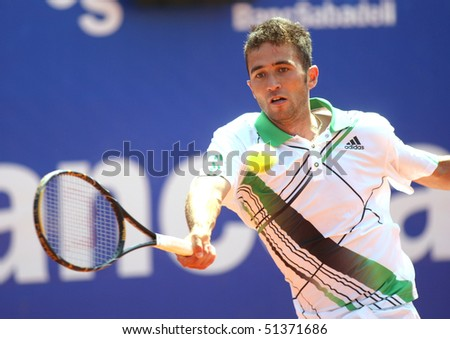 BARCELONA - APRIL 20: Turkish Marsel Ilhan in action during the first round match of the Barcelona tennis tournament Conde de Godo on April 20, 2010 in Barcelona, Spain.