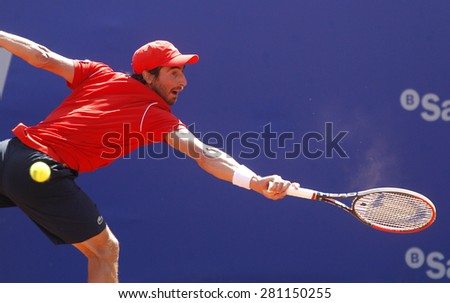 BARCELONA - APRIL, 23: Uruguayan tennis player Pablo Cuevas in action during a match of Barcelona tennis tournament Conde de Godo on April 23, 2015 in Barcelona - stock photo