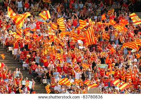 BARCELONA - APRIL 9: USAP Perpignan's supporters during the Heineken European Cup quarter-final match USAP Perpignan against RC Toulon at the Olympic Stadium in Barcelona, on April 9, 2011 - stock photo