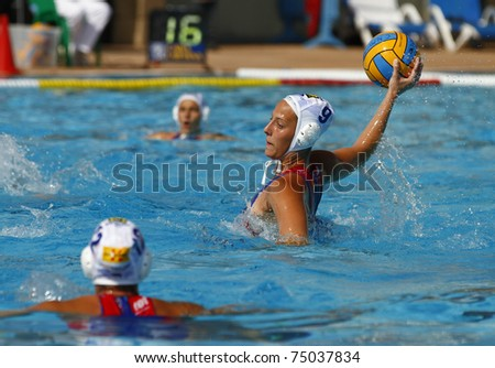 BARCELONA - APRIL 10: Water polo player in action during the women Spanish league match between CN Mataro and Sant Andreu, final score 4 - 7. April 10, 2011 in Mataro (Spain).